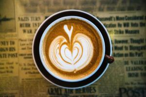 high-angle-view-of-cream-design-on-top-of-coffee